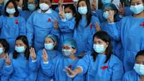 Myanmar medics wear red ribbons in coup protest
