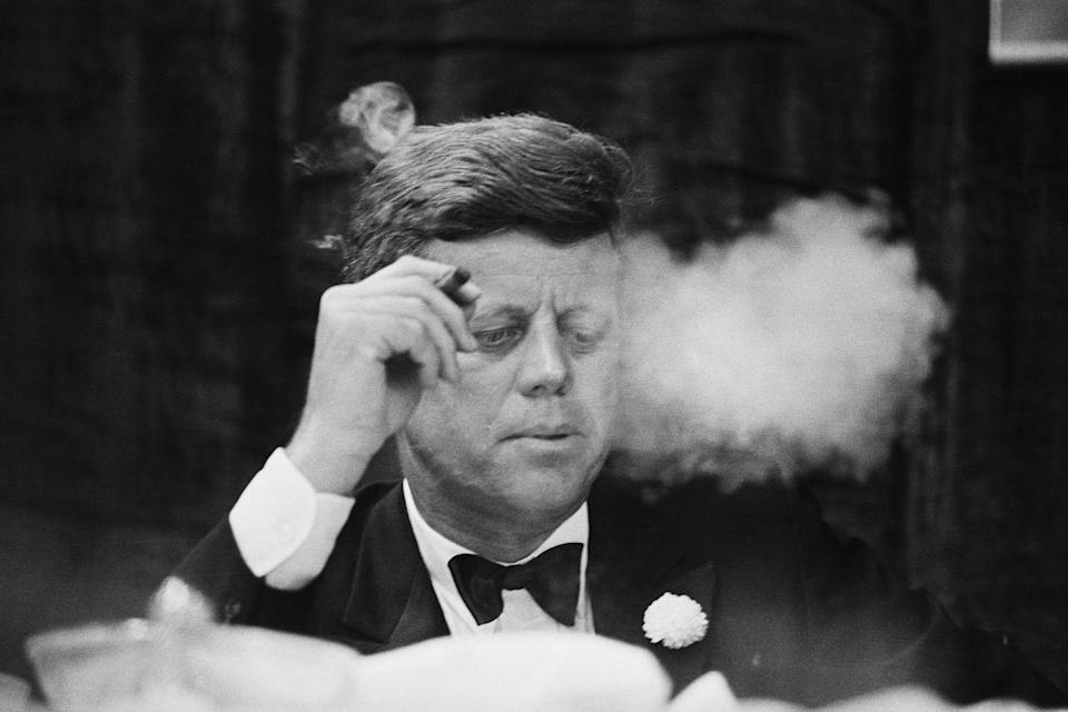"""<p>Before launching the commercial, economic, and financial embargo, JFK made sure that he had a hefty supply of his <a href=""""https://www.irishcentral.com/roots/history/dark-secrets-about-the-kennedy-family-you-didn-t-know"""" rel=""""nofollow noopener"""" target=""""_blank"""" data-ylk=""""slk:favorite Cuban cigars"""" class=""""link rapid-noclick-resp"""">favorite Cuban cigars</a>. </p>"""