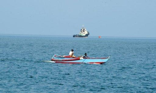 People in their motorised wooden boats are seen exploring the south China sea, in May. Southeast Asian nations should give top priority to easing tensions with Beijing in the South China Sea, Cambodia's premier said on Monday, as he stressed the importance of regional stability