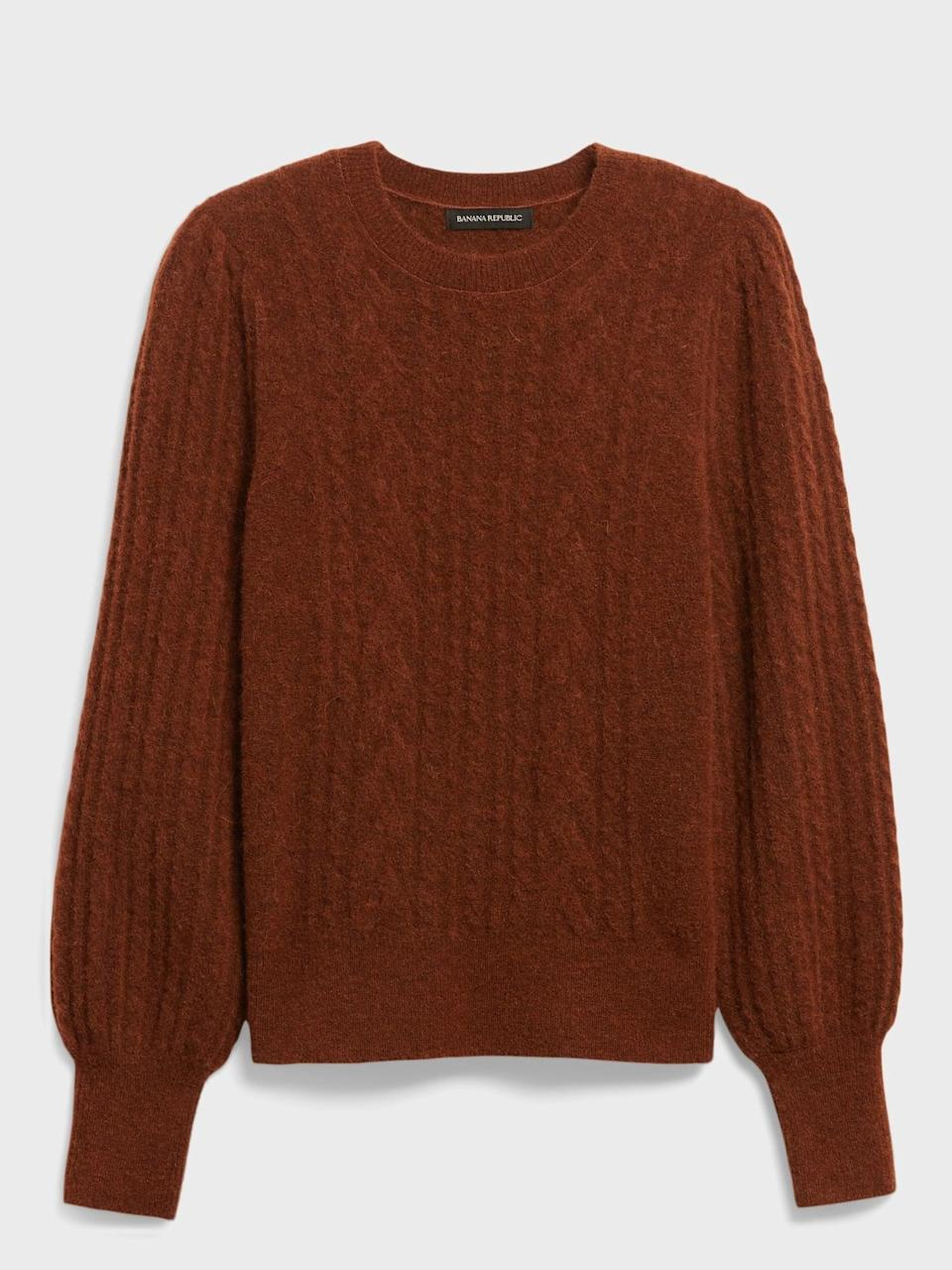 <p><span>Cable-Knit Puff-Sleeve Sweater</span> ($29, originally $99)</p>