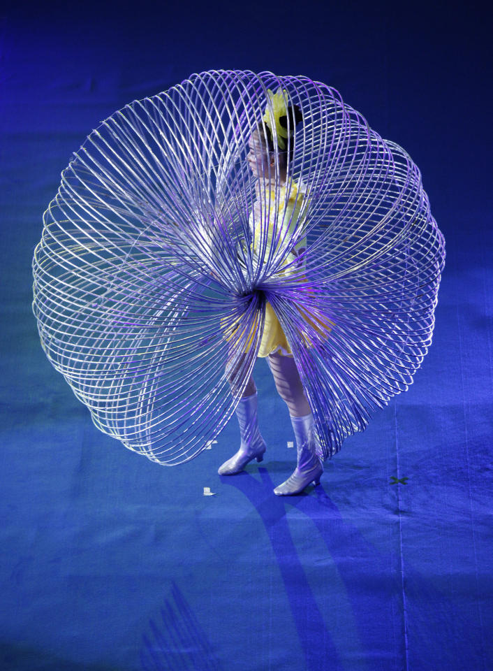 Jin Linlin, 2008 Guinness World Record holder of simultaneously spinning for 300 hula hoops, performs with 150 hula hoops during a promotional event at a shopping mall in Hong Kong Thursday, July 29, 2011. (AP Photo/Vincent Yu)