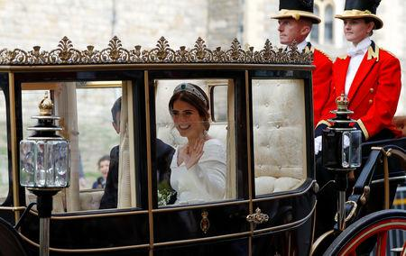 Britain's Princess Eugenie and Jack Brooksbank leave in a carriage after their wedding ceremony at Windsor Castle, Windsor, Britain October 12, 2018. REUTERS/Peter Nicholls