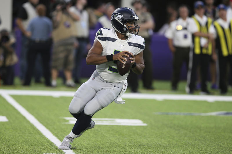 Seattle Seahawks quarterback Russell Wilson throws a pass during the first half of an NFL preseason football game against the Minnesota Vikings, Sunday, Aug. 18, 2019, in Minneapolis. (AP Photo/Jim Mone)