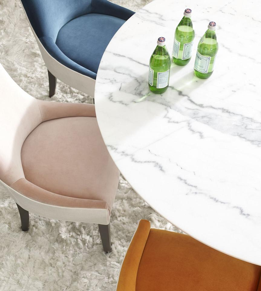 """<p>From their new Spring 2018 Collection, Mitchell Gold + Bob Williams introduces a luxurious Modern Round Dining Collection with many custom options, including rich white marble table tops. Also included in the collection: a plush and prismatic array of Ada dining chairs in the season's new vivid velvets.</p><p><a rel=""""nofollow"""" href=""""https://www.mgbwhome.com/"""">MGBWHOME.com</a></p>"""