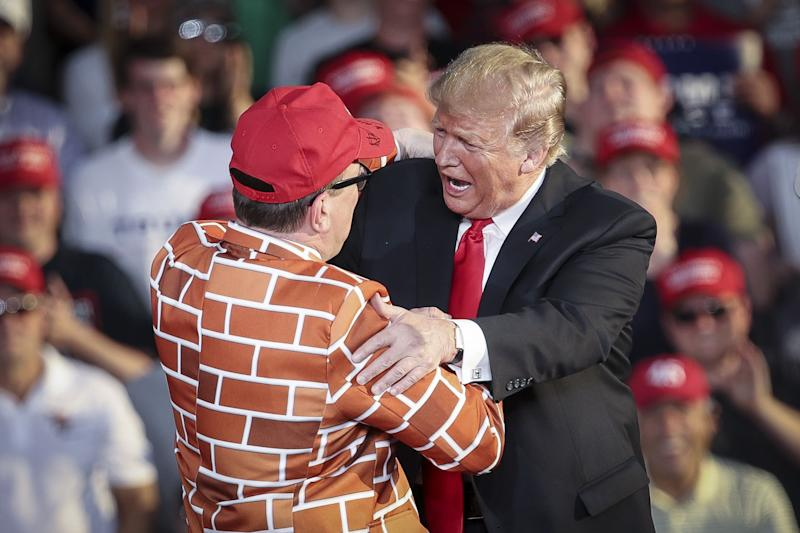 President Donald Trump calls up Blake Marnell, wearing a jacket with bricks representing a border wall, to the stage during a 'Make America Great Again' campaign rally at Williamsport Regional Airport, May 20, 2019 in Montoursville, Pennsylvania. Trump is making a trip to the swing state to drum up Republican support on the eve of a special election in Pennsylvania's 12th congressional district, with Republican Fred Keller facing off against Democrat Marc Friedenberg.