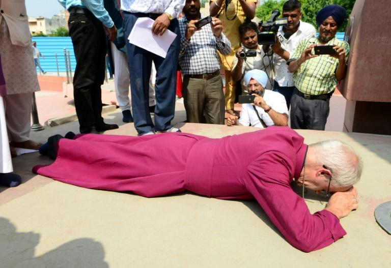 Archbishop of Canterbury Justin Welbypaid tributeto the hundreds of people killed at Amritsar in 1919 (AFP Photo/NARINDER NANU)