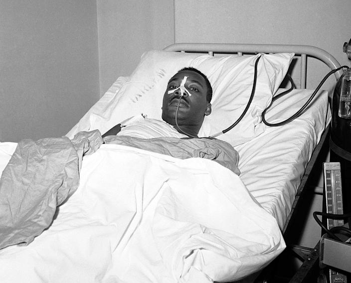 <p>Martin Luther King Jr. recovers from surgery in bed at New York's Harlem Hospital on following an operation to remove steel letter opener from his chest after being stabbed by a mentally disturbed woman as he signed books in Harlem, Sept. 21, 1958. (AP Photo/John Lent) </p>