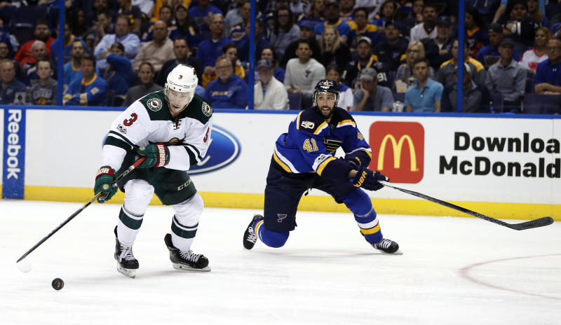 Minnesota Wild's Charlie Coyle (3) controls the puck as St. Louis Blues' Robert Bortuzzo defends during the third period in Game 4 of an NHL hockey first-round playoff series Wednesday, April 19, 2017, in St. Louis. The Wild won 2-0. (AP Photo/Jeff Roberson)