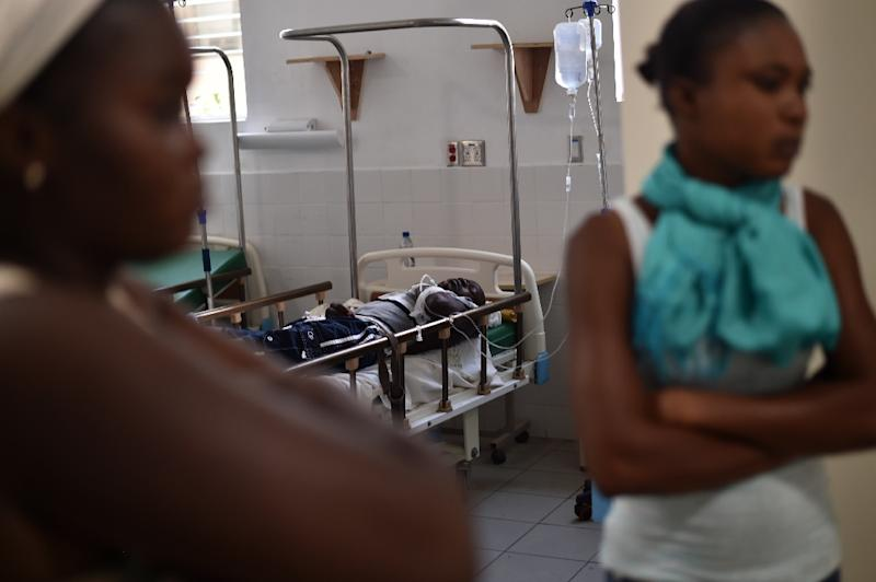 The victim of a transit accident is seen at La Providence Hospital on March 12, 2017 in Gonaives (AFP Photo/HECTOR RETAMAL)