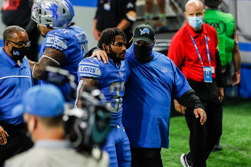 Detroit Lions head coach Matt Patricia and running back D'Andre Swift walk off the field after the Lions lost the season opener, 27-23, to the Chicago Bears at Ford Field in Detroit, Sunday, Sept. 13, 2020. Swift dropped what would have been the winning touchdown with 6 seconds left.