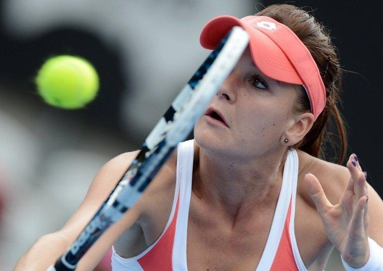 Agnieszka Radwanska returns a shot against Li Na during their semi-final at the Sydney International on January 10, 2013