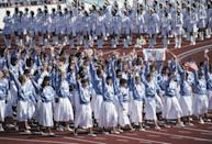 <p>In 1988, Team USA's designers traded in the traditional red, white, and blue for pastel blue knits with simple floral detailing, and long white skirts. </p>