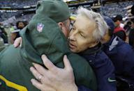 Green Bay Packers head coach Mike McCarthy, left, hugs Seattle Seahawks head coach Pete Carroll after overtime of the NFL football NFC Championship game Sunday, Jan. 18, 2015, in Seattle. The Seahawks won 28-22 to advance to Super Bowl XLIX. (AP Photo/David J. Phillip)