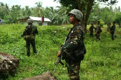Philippine assault on extremists sends 24,000 fleeing