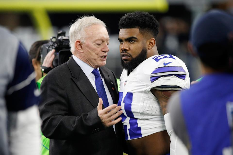 Dallas Cowboys owner and general manager Jerry Jones, left, won't stop taking digs at holdout running back Ezekiel Elliott. (Getty Images)