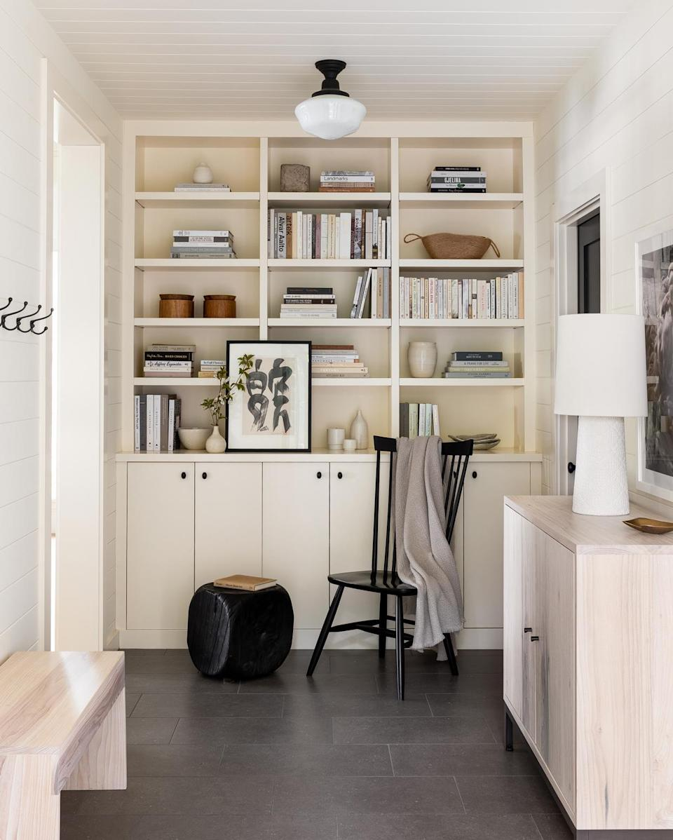 """<p><a href=""""https://www.marthastewart.com/275543/entryway-organizing-ideas"""" rel=""""nofollow noopener"""" target=""""_blank"""" data-ylk=""""slk:In the mudroom"""" class=""""link rapid-noclick-resp"""">In the mudroom</a>, Beers anchored an open corridor with stone floors that could resist scratches and stains—but still adhere to the black-and-white tones of the home.</p>"""