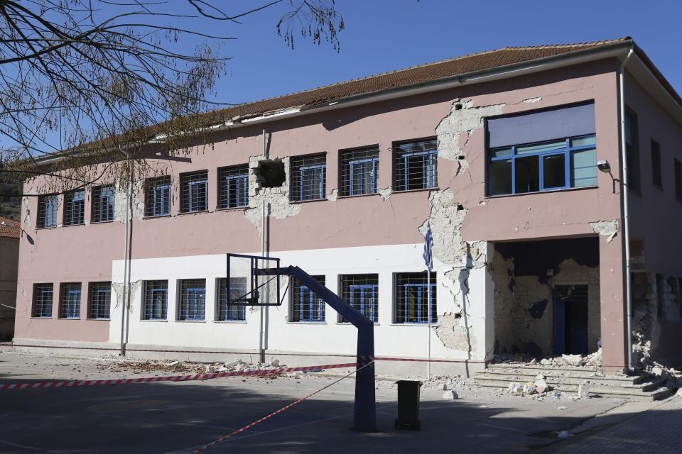 Damage is seen on the building of a primary school after an earthquake in Damasi village, central Greece, Wednesday, March 3, 2021. An earthquake with a preliminary magnitude of up to 6.3 struck central Greece on Wednesday and was felt as far away as the capitals of neighboring Albania, North Macedonia, Kosovo and Montenegro. (AP Photo/Vaggelis Kousioras)