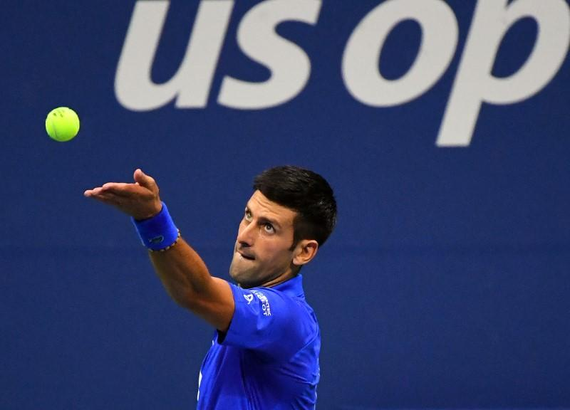 Djokovic rolls into second round with win over Dzumhur