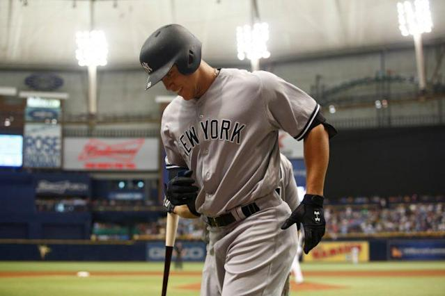 "<a class=""link rapid-noclick-resp"" href=""/mlb/players/9877/"" data-ylk=""slk:Aaron Judge"">Aaron Judge</a> trots off the field after a game against the Rays in May (Getty Images)."