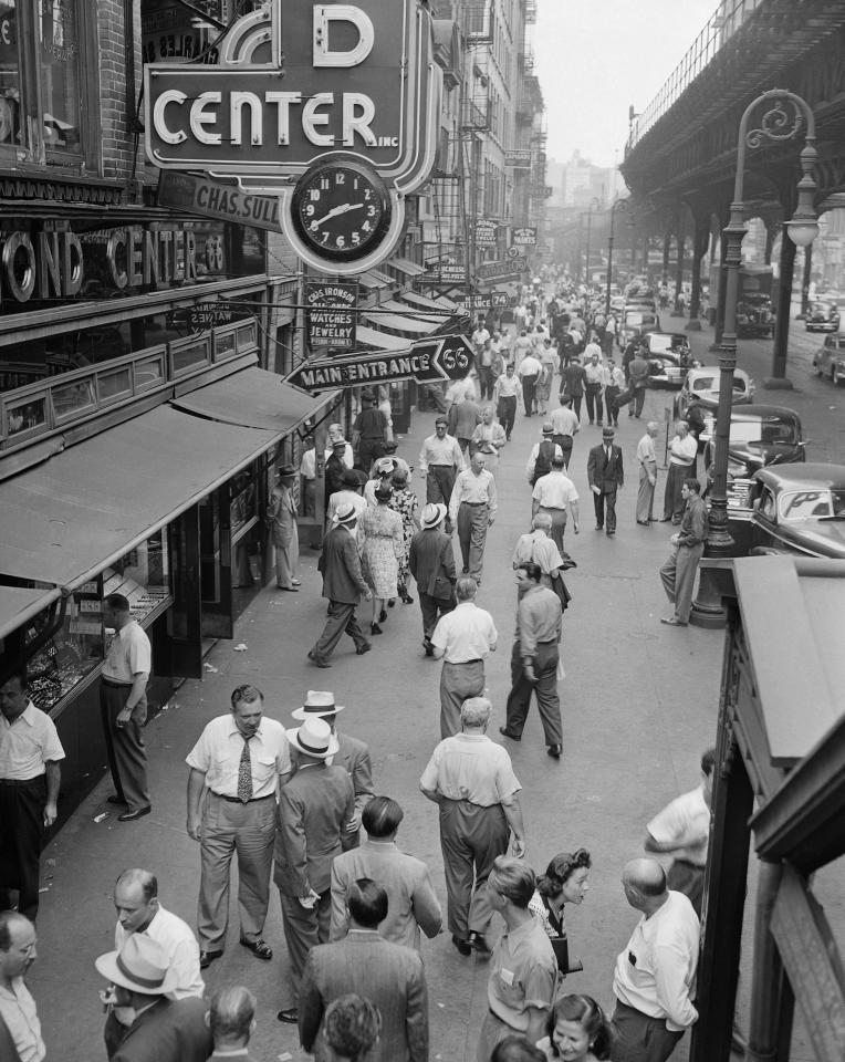 Shoppers and merchants crowd the sidewalk on the Bowery on New York's Lower East Side in this undated photo. This stretch of the Bowery was known for its jewelry shops. The Third Avenue EL is at right. (AP Photo/Bob Kradin)