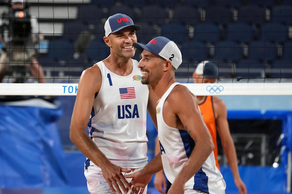 Phil Dalhausser and Nick Lucena (USA) celebrate during the Tokyo 2020 Olympic Summer Games at Shiokaze Park.