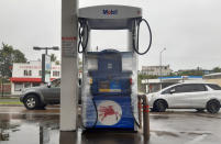 A gas pump is wrapped in the preparation for cyclone Yasa in Suva, Fiji, Thursday, Dec. 17, 2020. Fiji was urging people near the coast to move to higher ground Thursday ahead of a nationwide curfew as the island nation prepared for a major cyclone to hit.(AP Photo/Aileen Torres-Bennett)