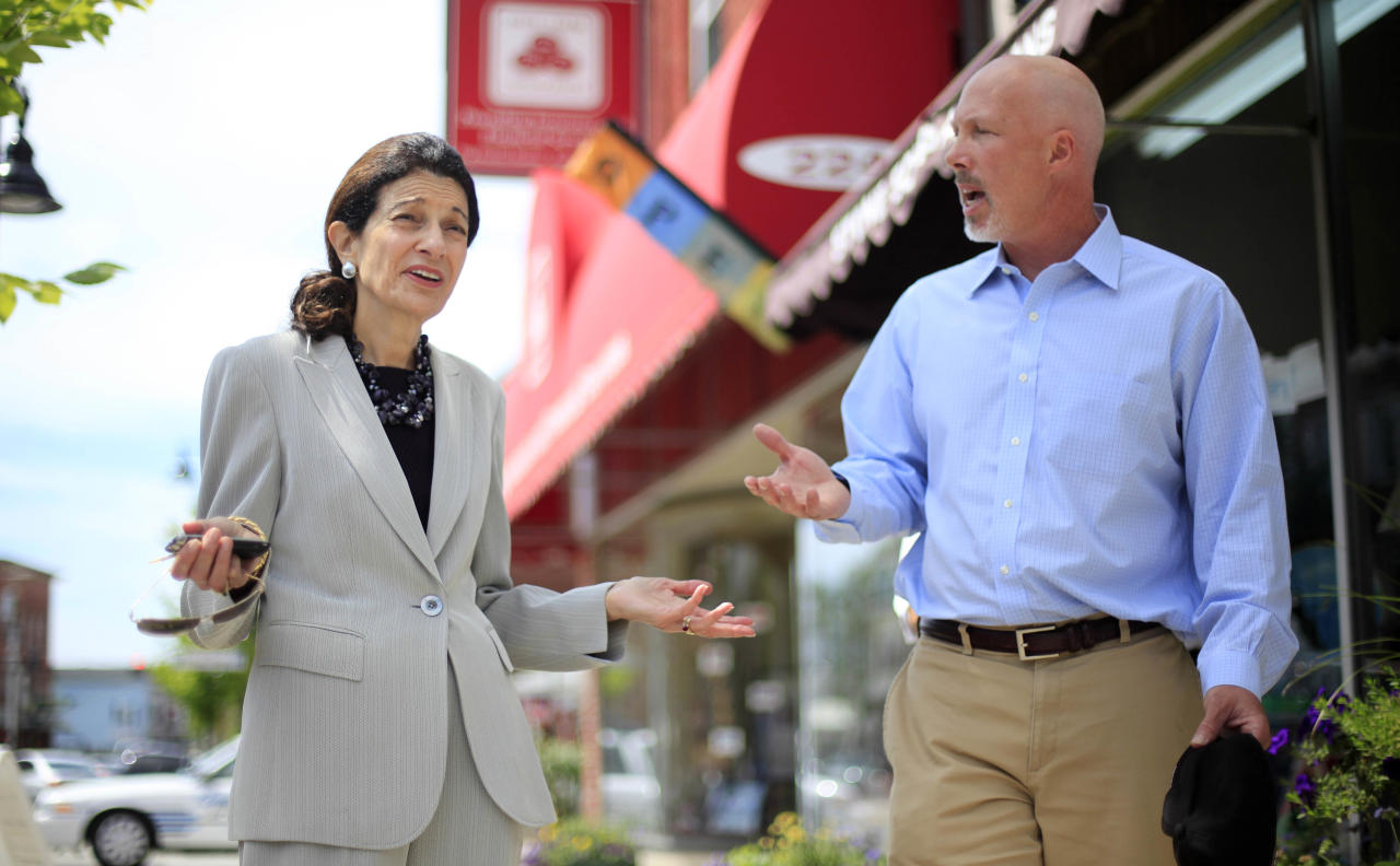 """Sen. Olympia Snowe, R-Maine, speaks with Ian Engleman, of Scarborough, Maine, during her """"Main Street Walk"""" to visit with constituents and answer questions, Tuesday, Aug. 9, 2011, in Saco, Maine. (AP Photo/Robert F. Bukaty)"""