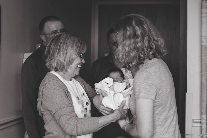 """""""Grandma meeting her adoptive granddaughter for thevery first timeand couple telling grandma that she is named after her.Amazing moment"""" -- Brooke Smith"""