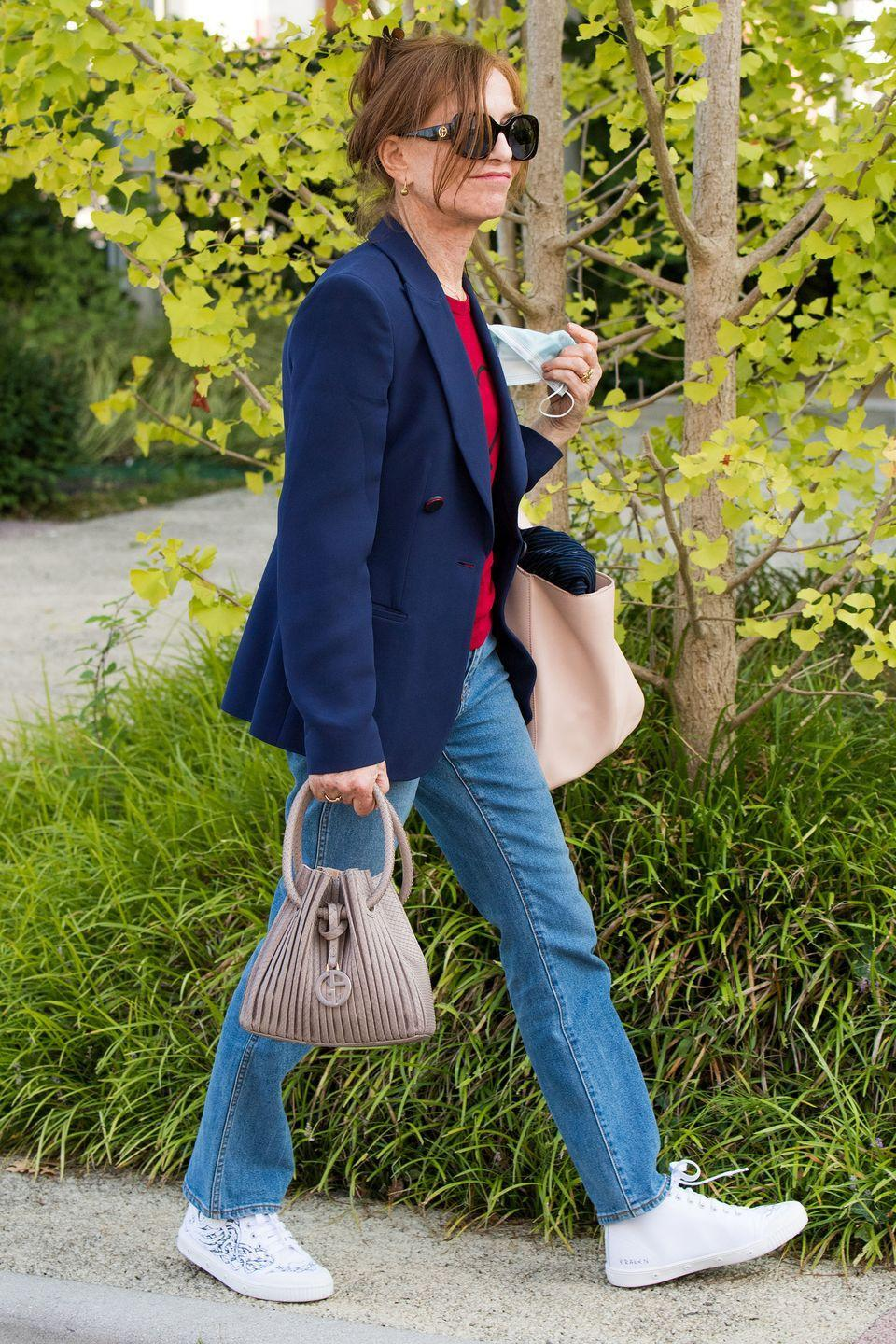 <p>Isabelle Huppert was seen in Venice demonstrating the perfect smart-casual look in a blazer and jeans. </p>