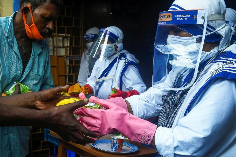 India tops four million virus cases as pandemic rages