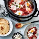 <p>Start your day with hearty, slightly spicy shakshuka full of Southwestern flavor. To avoid one large egg blob on top, be sure to make wells in the sauce using a spoon. It's important to use corn tortillas and not flour tortillas if you're going gluten free. Lightly toast the tortillas, if desired.</p>