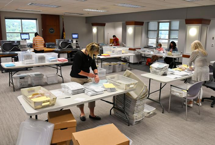 Election workers in Reading, Pennsylvania, open mail-in and absentee ballots on June 3. (Photo: Ben Hasty/MediaNews Group/Reading Eagle via Getty Images)