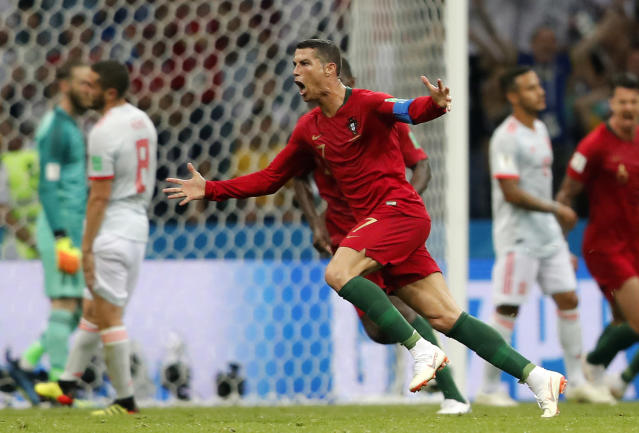 Portugal's Cristiano Ronaldo celebrates after he scored his third goal with a free kick during the group B match between Portugal and Spain at the 2018 soccer World Cup in the Fisht Stadium in Sochi, Russia, Friday, June 15, 2018. (AP Photo/Frank Augstein)