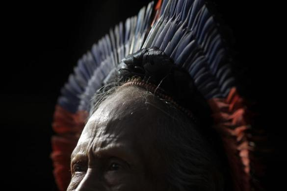 """Kwykyti, 63, of the Kayapo tribe, waits for a medical exam on the first day of a visit by the """"Expedicionarios da Saude"""" (Brazilian Health Expeditions), in the Kikretum community in Sao Felix, northern Brazil, April 22, 2011."""