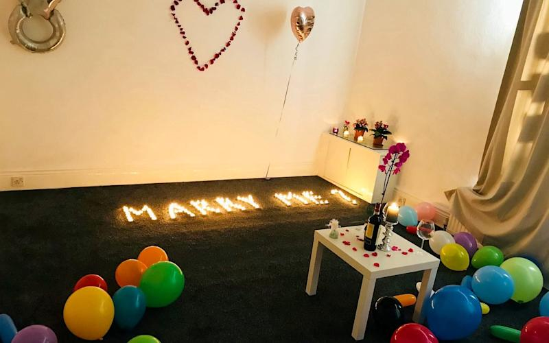 Mr Ndreu spelled out 'Marry me?' in tea lights but it didn't go to plan - SWNS