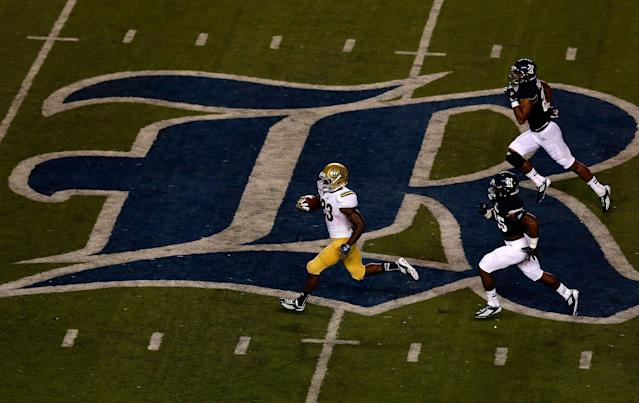 HOUSTON, TX - AUGUST 30: Johnathan Franklin #23 of the UCLA Bruins runs for a 78 yard touchdown in the second quarter of the game against the Rice Owls at Rice Stadium on August 30, 2012 in Houston, Texas. (Photo by Scott Halleran/Getty Images)