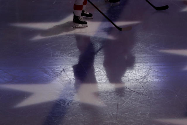 """<a class=""""link rapid-noclick-resp"""" href=""""/nhl/teams/detroit/"""" data-ylk=""""slk:Detroit Red Wings"""">Detroit Red Wings</a>' Dylan Larkin, left, and Brian Lashoff stand on the ice for the singing of the national anthem before an NHL hockey game against the <a class=""""link rapid-noclick-resp"""" href=""""/nhl/teams/chicago/"""" data-ylk=""""slk:Chicago Blackhawks"""">Chicago Blackhawks</a> in Chicago, Sunday, Jan. 5, 2020. (AP Photo/Nam Y. Huh)"""