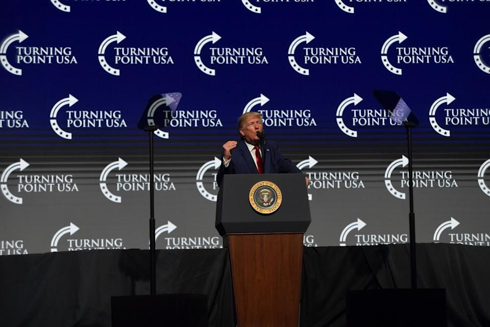 Donald Trump speaks at a Turning Point USA summit in 2019.