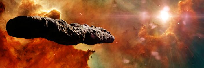 asteroid in deep space lit by a star