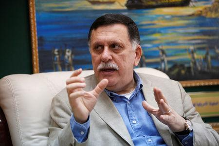 FILE PHOTO: Prime Minister of Libya's unity government Fayez Seraj speaks during an interview with Reuters at his office in the naval base of Tripoli