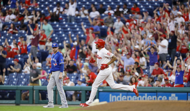 Philadelphia Phillies' Zach Eflin, right, rounds the bases past Toronto Blue Jays first baseman Justin Smoak, left, after hitting a home run off starting pitcher Sam Gaviglio during the third inning of a baseball game, Friday, May 25, 2018, in Philadelphia. (AP Photo/Matt Slocum)