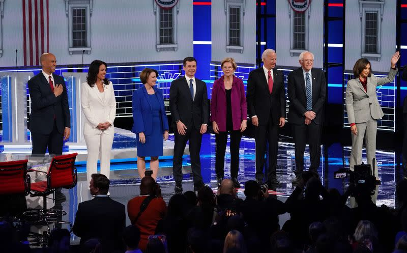 Democratic U.S. presidential candidates pose at the start of their fifth 2020 campaign debate at the Tyler Perry Studios in Atlanta