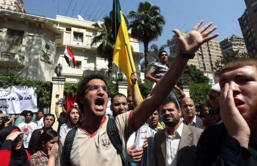 Egyptian protesters take part in a demonstration in front of the Saudi Arabian embassy in Cairo on April 24. Saudi Arabia decided to recall its ambassador to Cairo and close diplomatic missions in Egypt after protests outside its embassy over an arrested Egyptian
