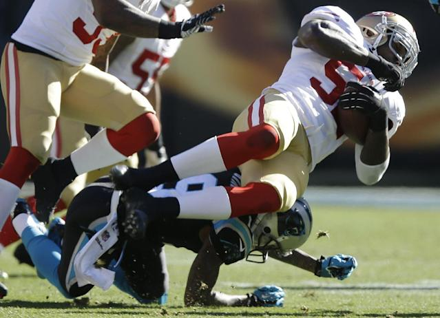 Carolina Panthers wide receiver Ted Ginn (19) tackles San Francisco 49ers inside linebacker Patrick Willis (52) after Willis intercepted the ball during the first half of a divisional playoff NFL football game, Sunday, Jan. 12, 2014, in Charlotte, N.C. (AP Photo/Gerry Broome)