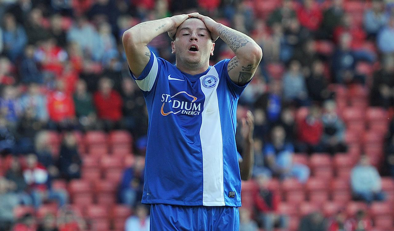 Peterborough United's Lee Tomlin shows his dejection after a missed chance against Crewe Alexandra, during the Sky Bet Football League One match at the Alexandra Stadium, Crewe.