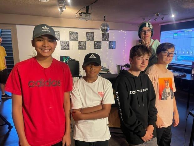 Students of a weekly electronic dance music summer camp in Edmonton get a lesson in DJing and producing the genre from experienced pros. (Travis McEwan/CBC - image credit)