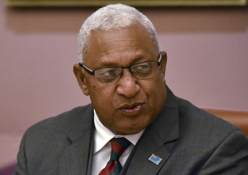 Fiji's Prime Minister Voreqe Bainimarama sits down to bilateral meetings with Australian Prime Minister Scott Morrison at Parliament House in Canberra, Monday, Sept. 16, 2019. (Mick Tsikas/Pool via AP)