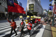 Myanmar people living in Japan and supporters march during a protest in Sunday, Feb. 14, 2021, in Tokyo. Thousands of people from Myanmar living in Japan have marched in downtown Tokyo to protest the military coup back home. (AP Photo/Eugene Hoshiko)