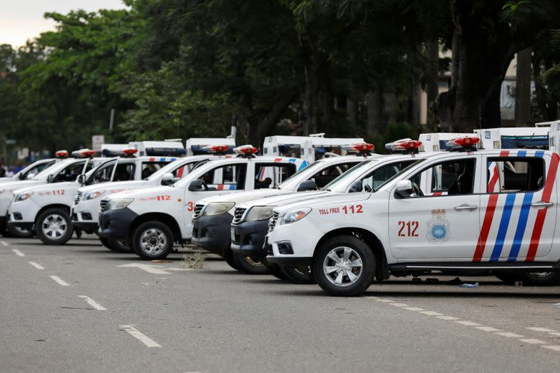 Police vehicles are seen parked during a protest in Lagos