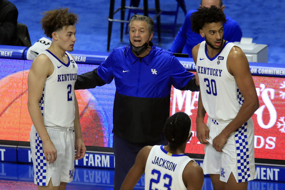 Kentucky coach John Calipari, center, talks to Devin Askew (2), Olivier Sarr (30) and Isaiah Jackson (23) during the second half of the team's NCAA college basketball game against Morehead State in Lexington, Ky., Wednesday, Nov. 25, 2020. (AP Photo/James Crisp)